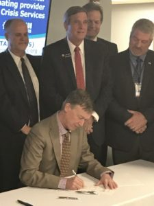 Governor Hickenlooper signing SB17-207 into law